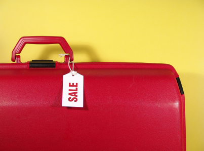 suitcase with sale tag
