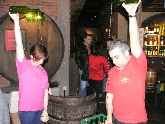 A demo of traditional pouring technique at a gala at the Cider Museum in Asturias, Spain.