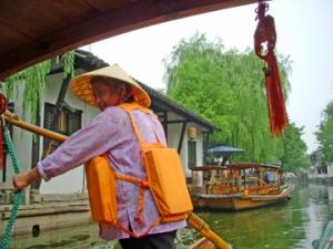 Gondolier on canal in Zhujiajiao China